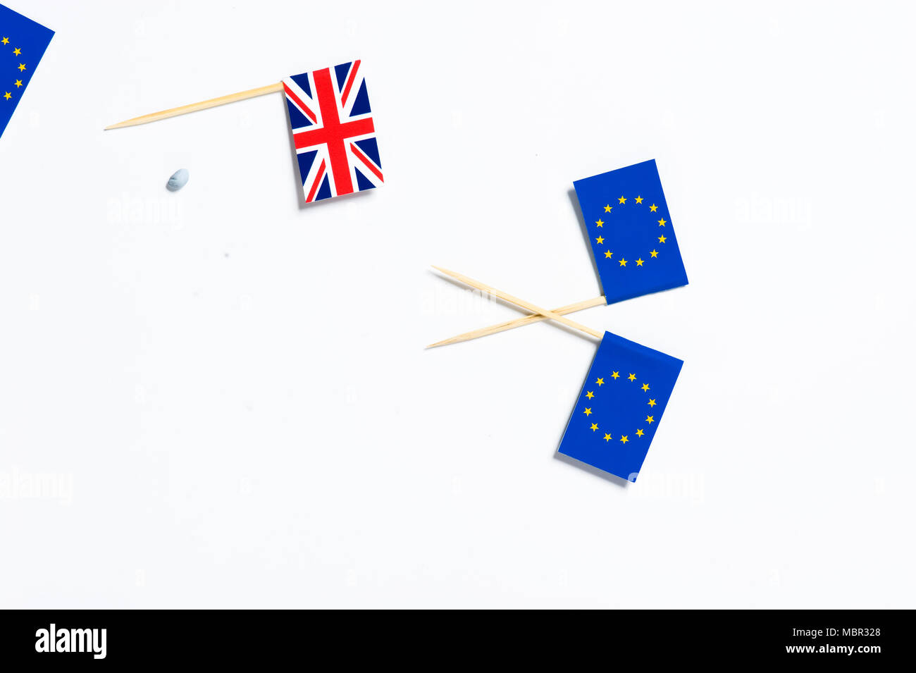 One Union Jack flag and two European Union flags on a white background - Stock Image