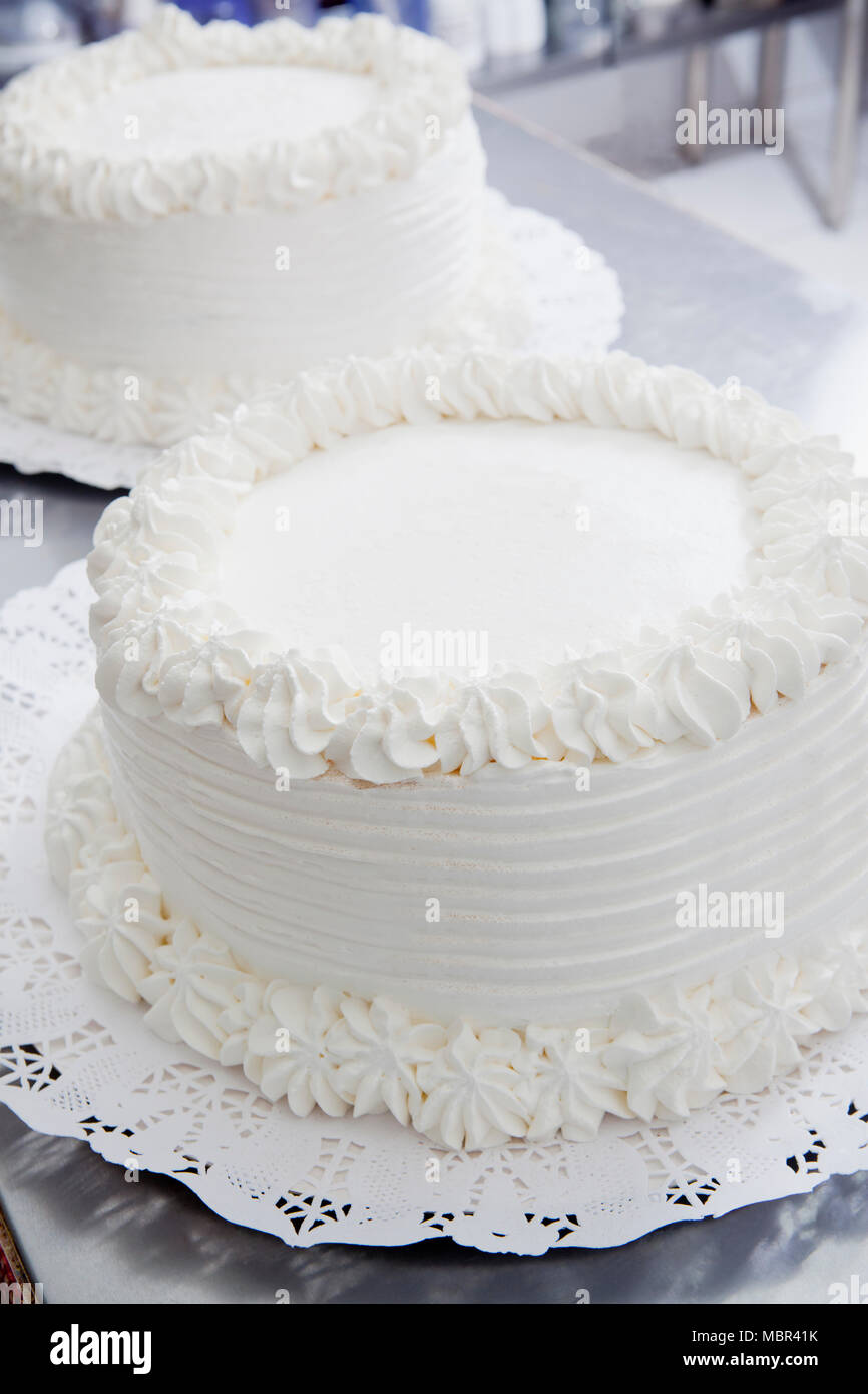 White Frosting Cakes - Stock Image