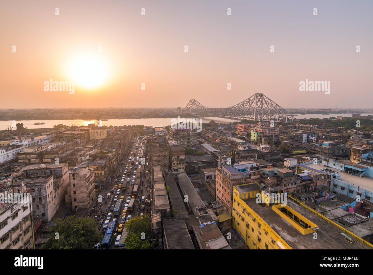 Aerial view of Kolkata city, India. Beautiful sunset over the famous Howrah bridge - The historic cantilever bridge on the river Hooghly, Calcutta, In - Stock Image