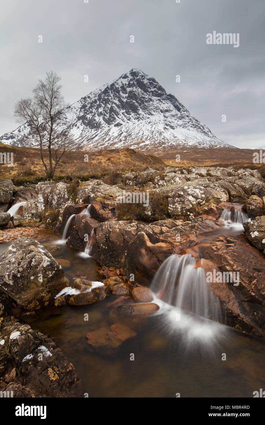 Scottish mountain Buachaille Etive Mòr and waterfall on River Coupall in winter in Glen Etive near Glencoe in the Highlands of Scotland, UK - Stock Image