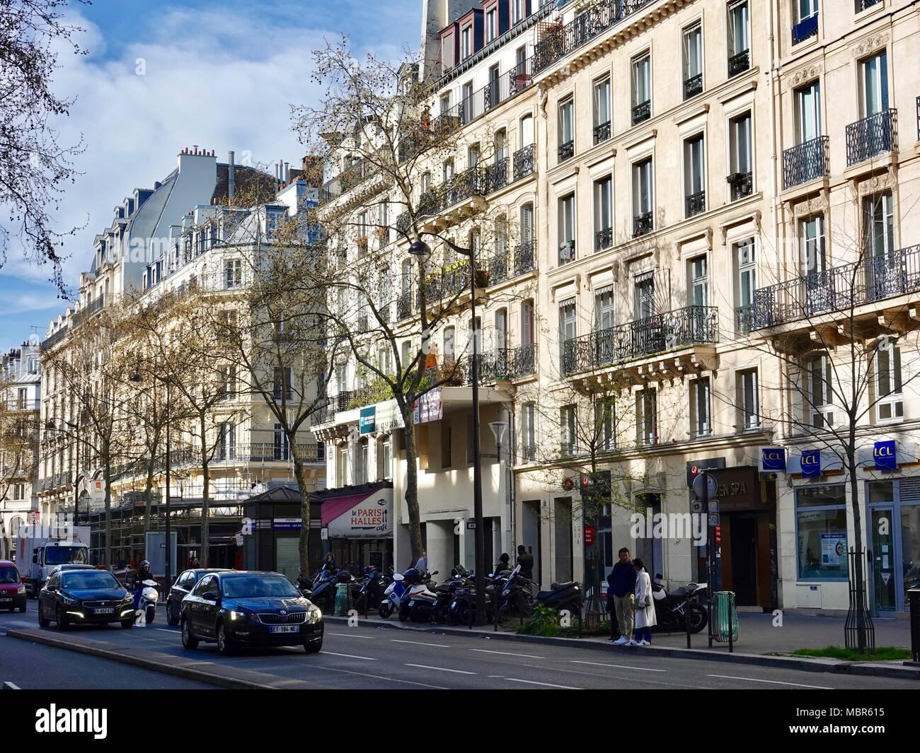 Morning traffic and pedestrians, buildings, on Boulevard de Sébastopol in the 1st Arrondissement of Paris, France. - Stock Image