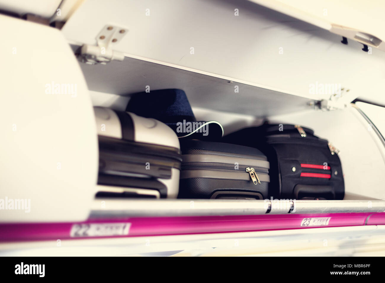 hand-luggage compartment with suitcases in airplane. carry-on