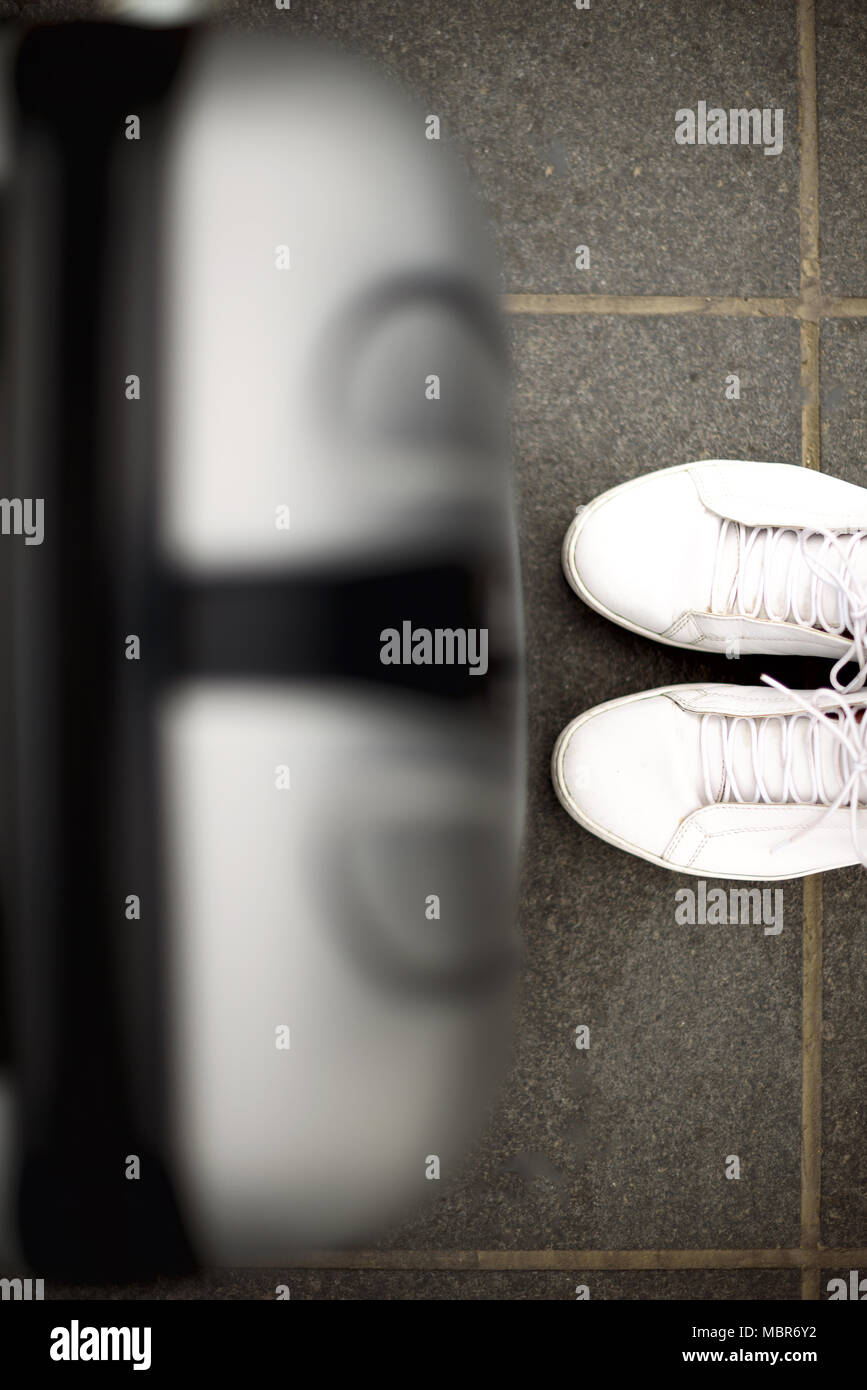 Aerial top view with copy space. White sneakers and travel suitcase. Travel and vacation concept - Stock Image