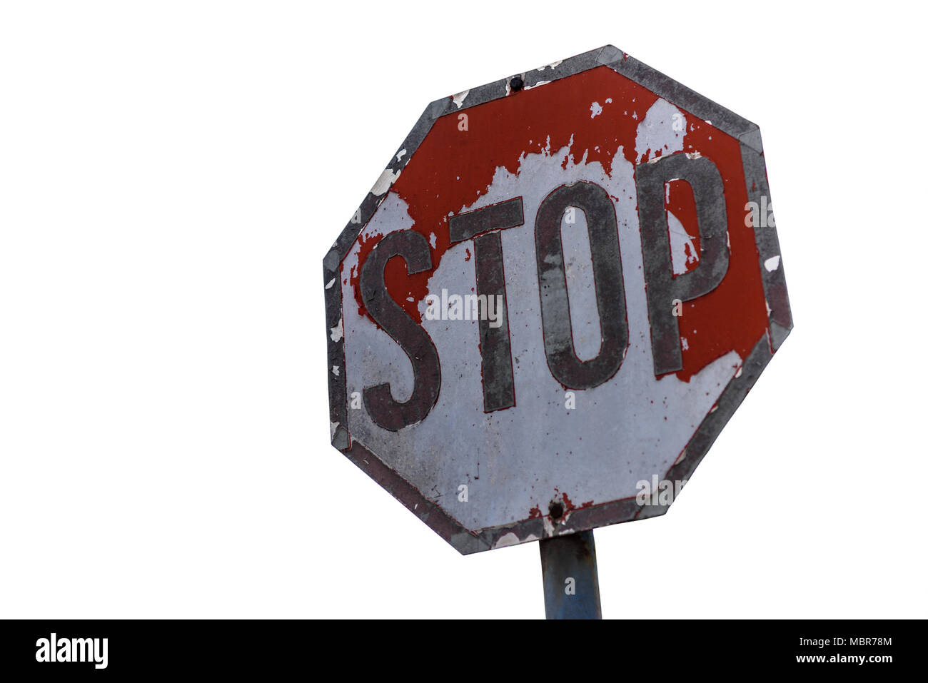 Old Weathered Stop Sign With Peeling Paint Isolated On White