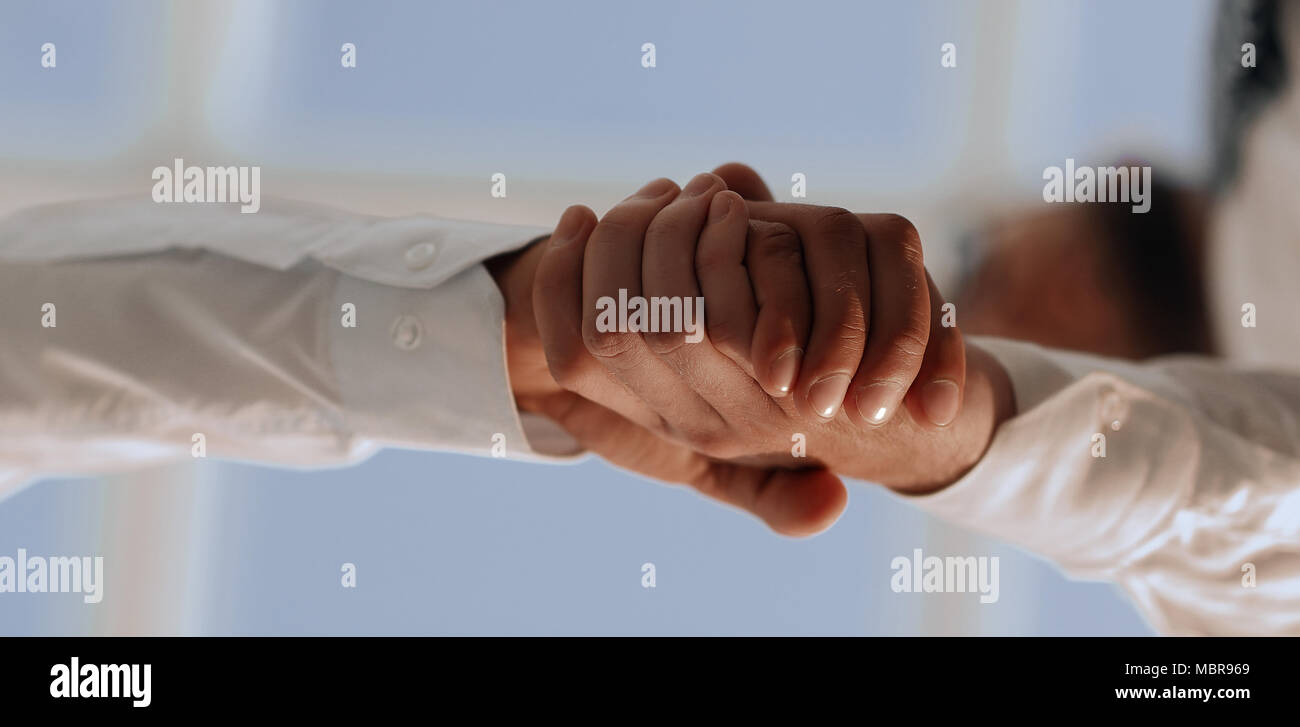 Close-up photo of handshake of two successful businessmen - Stock Image