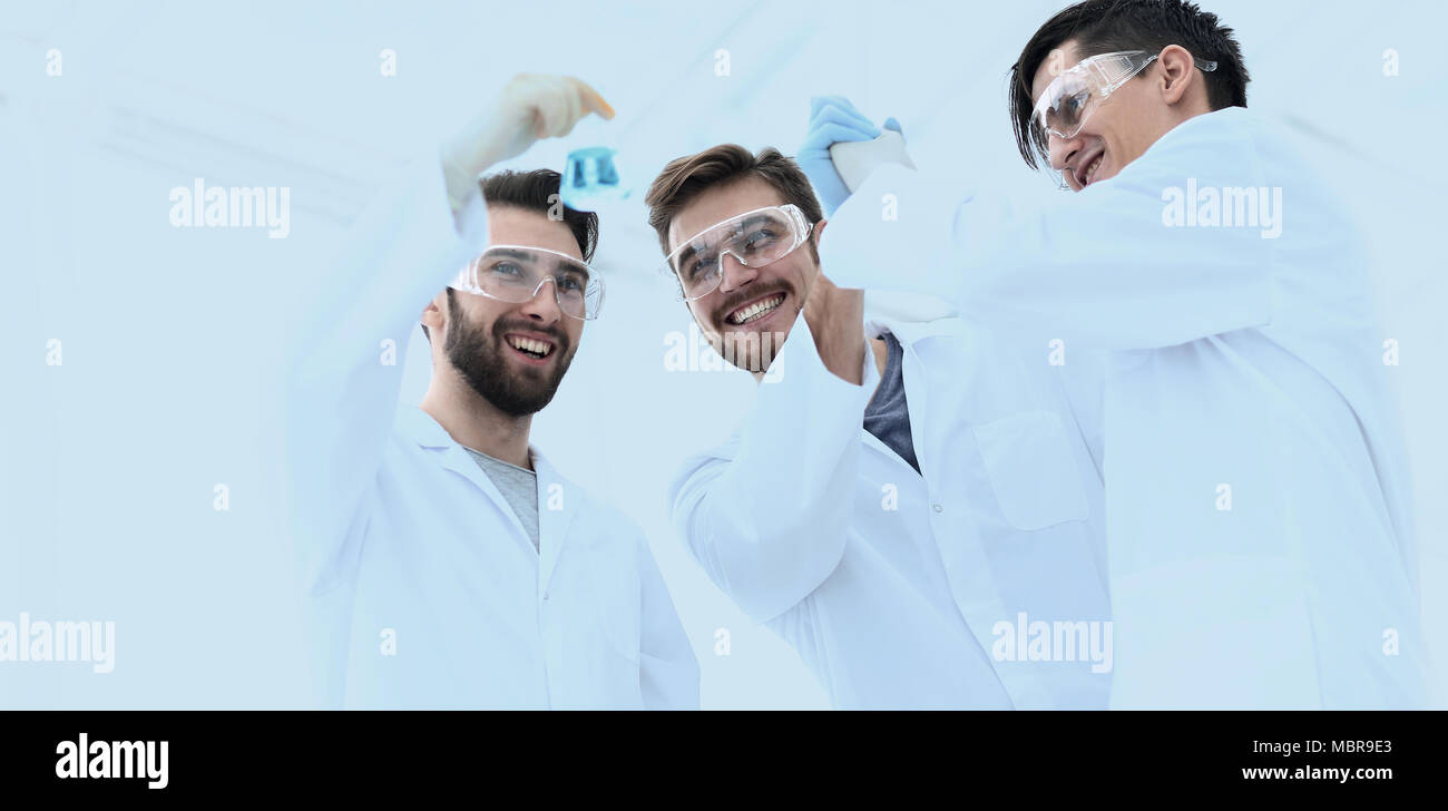 happy scientists look at the result of their work - Stock Image
