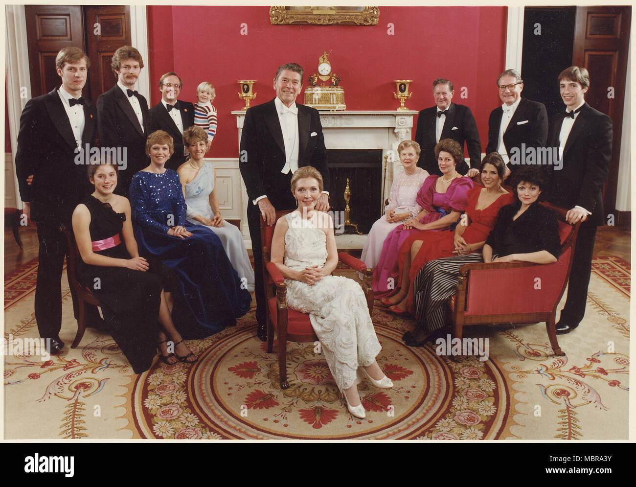 1981 Presidential Inaugural Family Photo:(standing from left to right) Geoffrey Davis, Dennis Revell, Michael Reagan, Cameron Reagan, President Reagan, Neil Reagan, Dr. Richard David, Ron Junior. (sitting from left to right) Anne Davis, Maureen Reagan, Colleen Reagan, Mrs. Reagan, Bess Reagan, Patricia Davis, Patti Davis, Doria Reagan - Stock Image