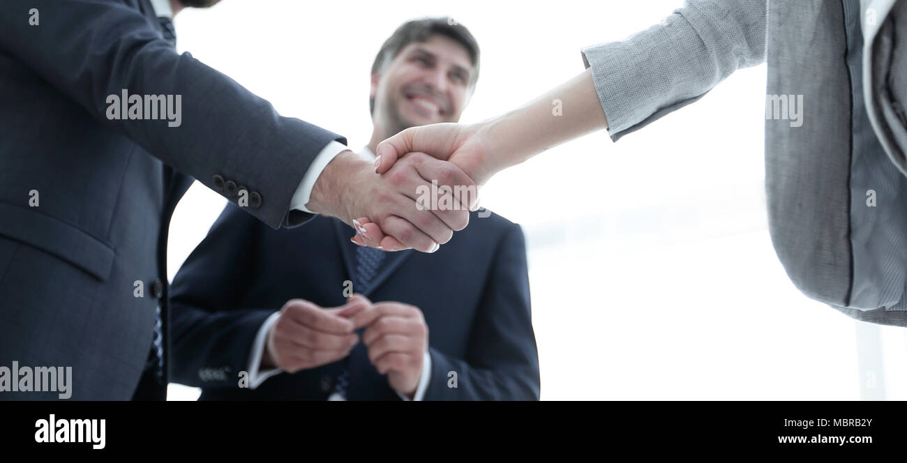 Handshake of business partners before the talks. - Stock Image