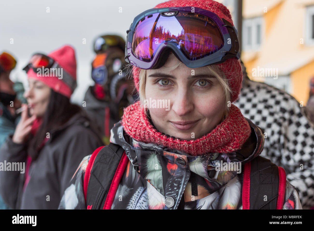 Snowboard pretty blonde girl with green eyes wearing purple mask and orange  hat with scarf looking cae05d69fb97