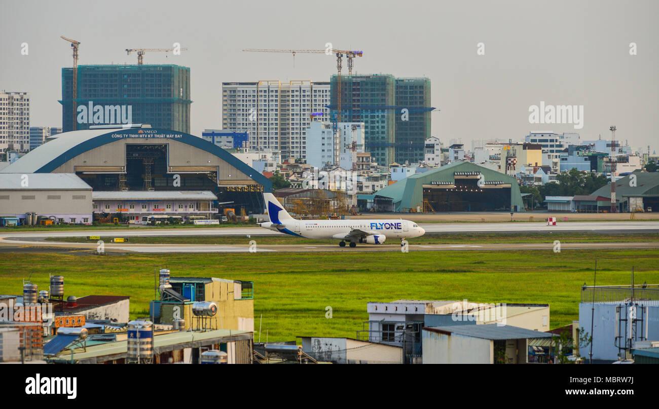 Saigon, Vietnam - Mar 11, 2018. Aircrafts on runway at Tan Son Nhat Airport in Saigon (Ho Chi Minh City), Vietnam. Stock Photo