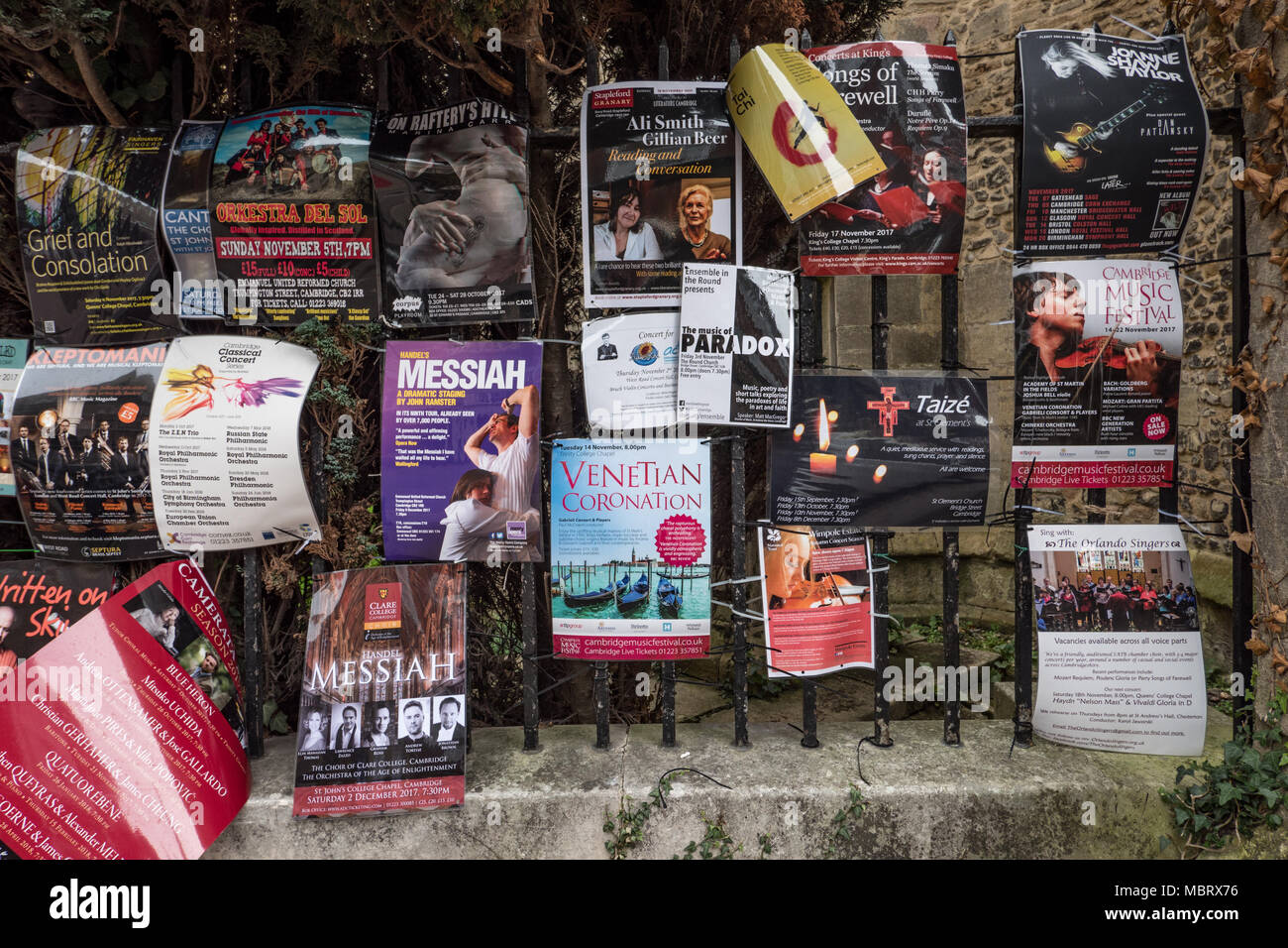Promotional posters advertising classical music concerts and talks. Posters are attached to railings in the university city of Cambridge, England UK. - Stock Image