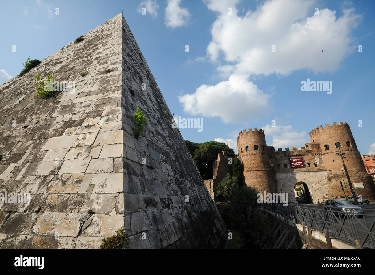 Piramide di Caio Cestio or Piramide Cestia (Pyramid of Cestius) and Porta San Paolo (San Paolo Gate) in Aurelian Walls in Historic Centre of Rome list Stock Photo