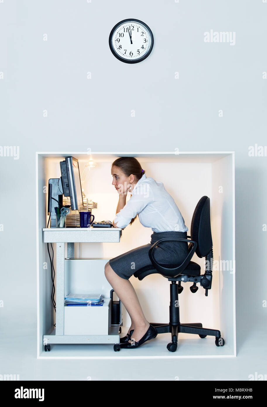 Woman Working In Tiny Office Cubicle
