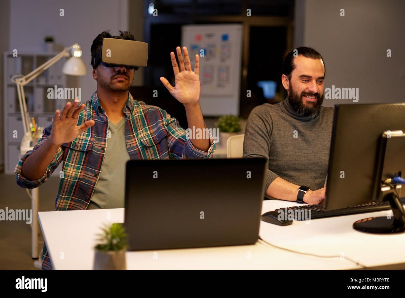 creative man in virtual reality headset at office - Stock Image