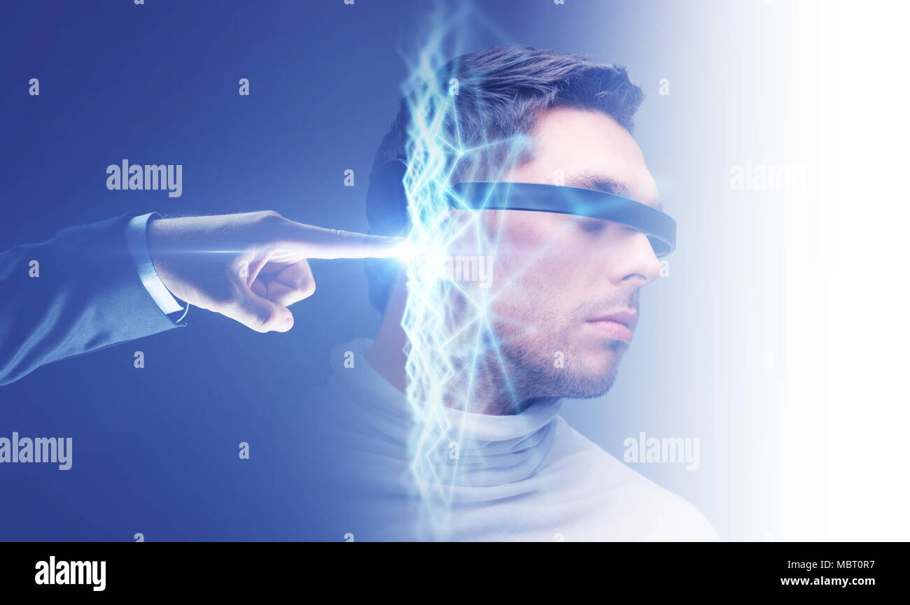 businessman hand connecting to virtual network - Stock Image