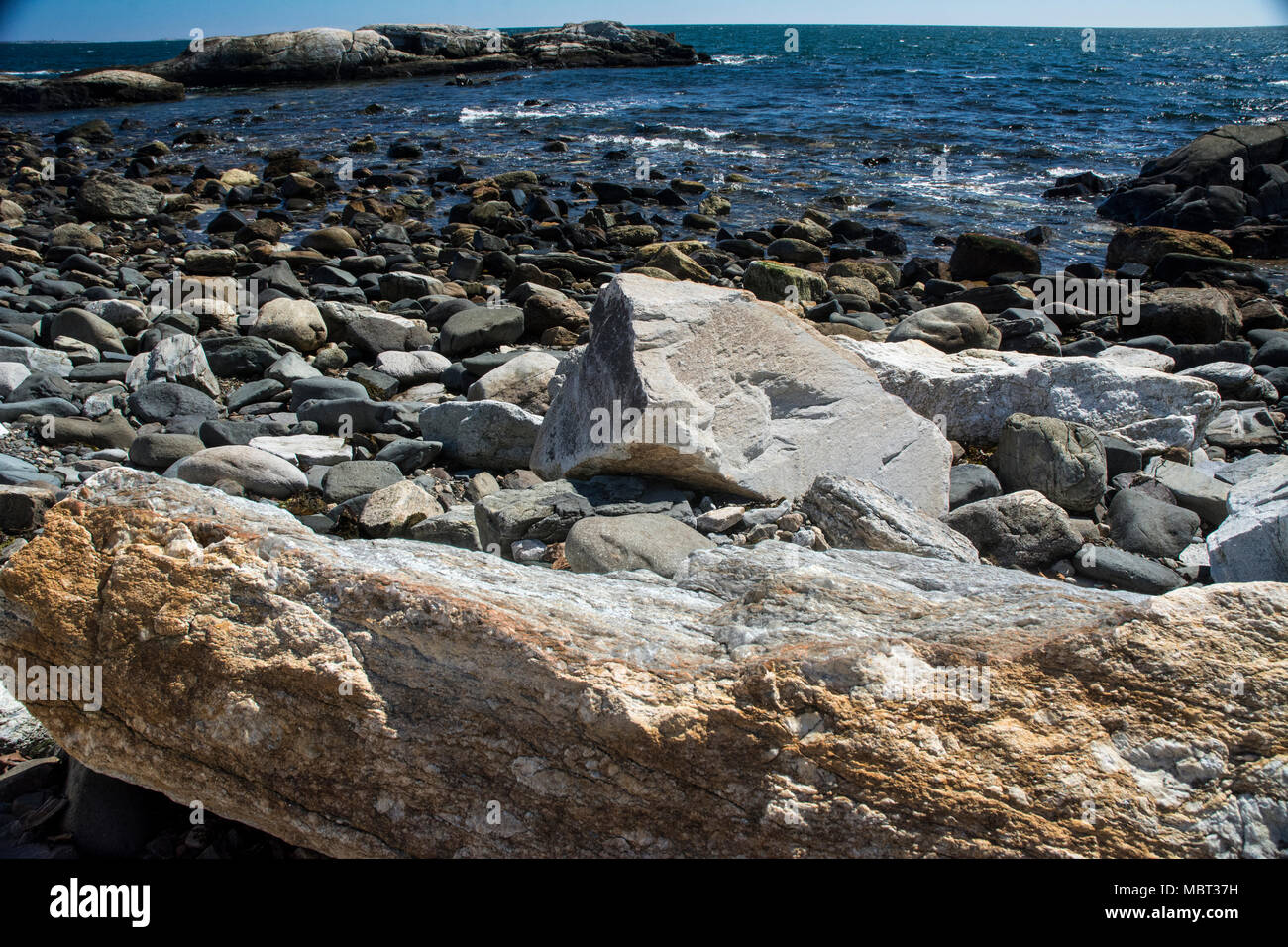 Rocky coastline is a signature of New England, USA. - Stock Image