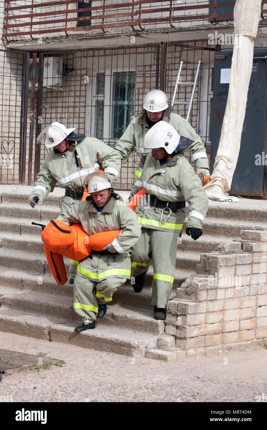 Yartsevo, Russia - August 26, 2011: Firefighters evacuated the injured Stock Photo
