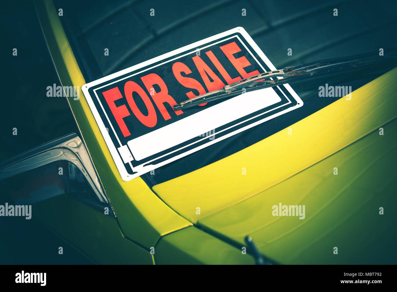 Car For Sale Sign Under Windshield Wiper. Closeup Photo. Vehicle Selling Theme. Stock Photo