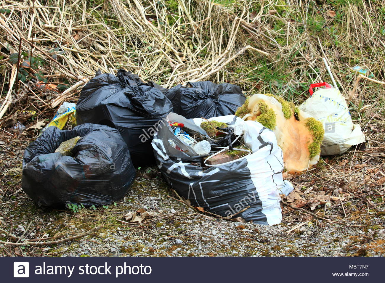 Household rubbish dumped on recreational ground along the canal in Staybridge Cheshire Tameside England - Stock Image