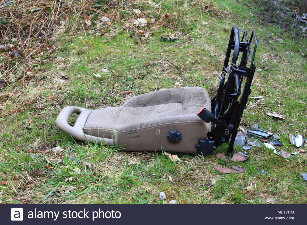 A car seat dumped on recreational ground along the canal in Staybridge Cheshire Tameside England - Stock Image