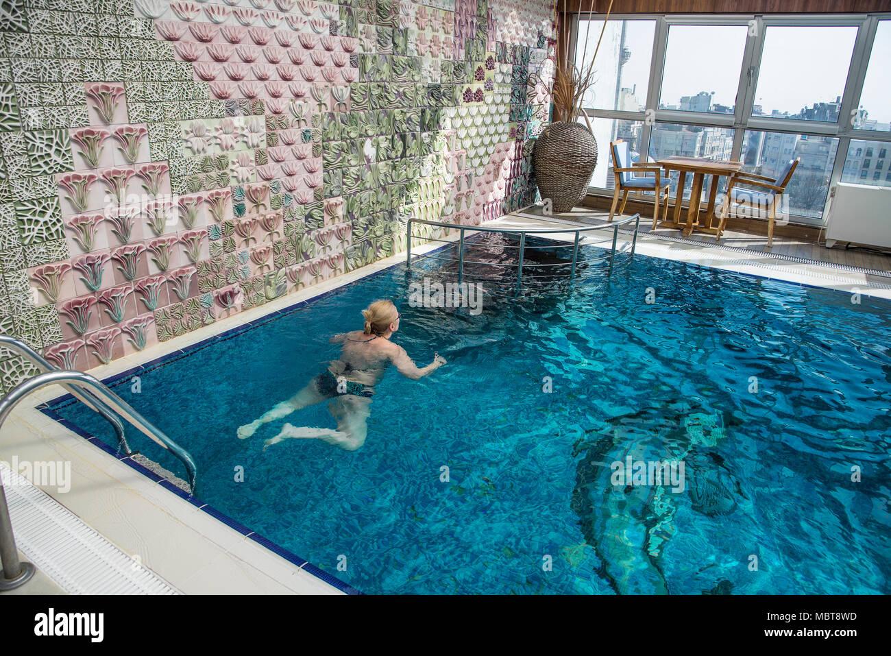 Blonde mature on pool