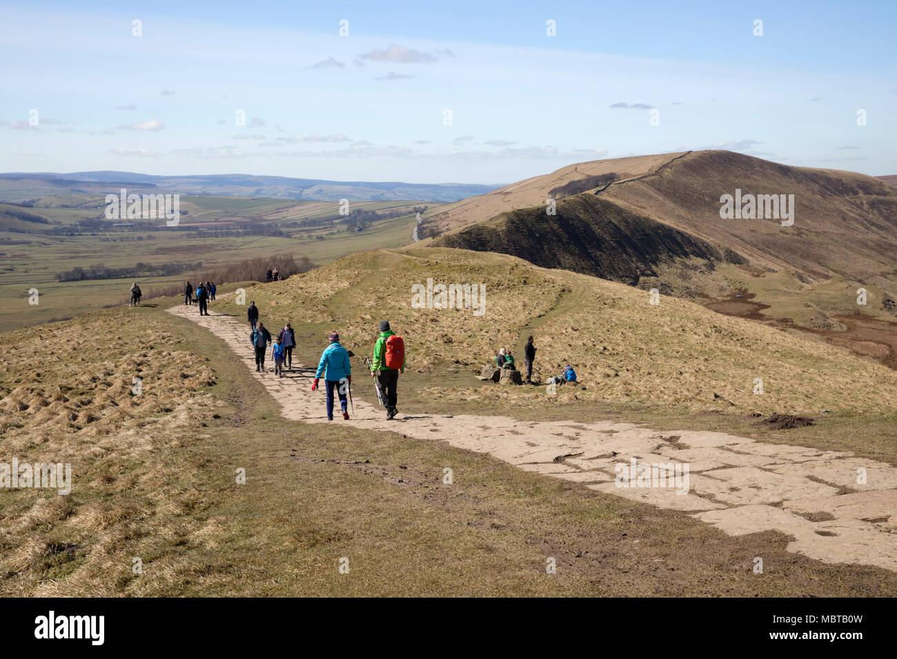 Walkers descending summit of Mam Tor, Castleton, Peak District National Park, Derbyshire, England, United Kingdom, Europe - Stock Image