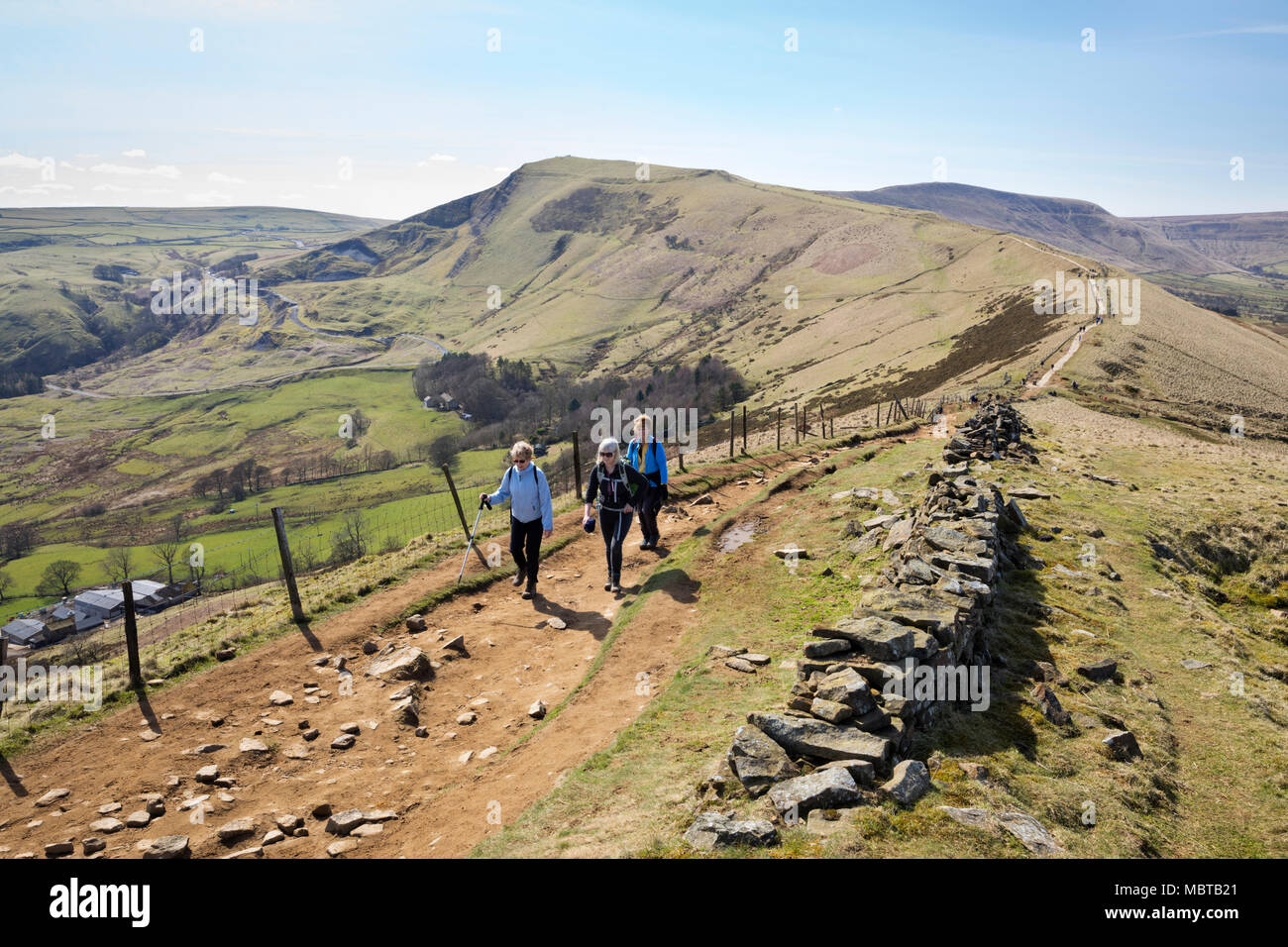 Walkers on the Great Ridge walk at Hollins Cross with view of Mam Tor and Hope and Edale valleys, Castleton, Peak District National Park - Stock Image