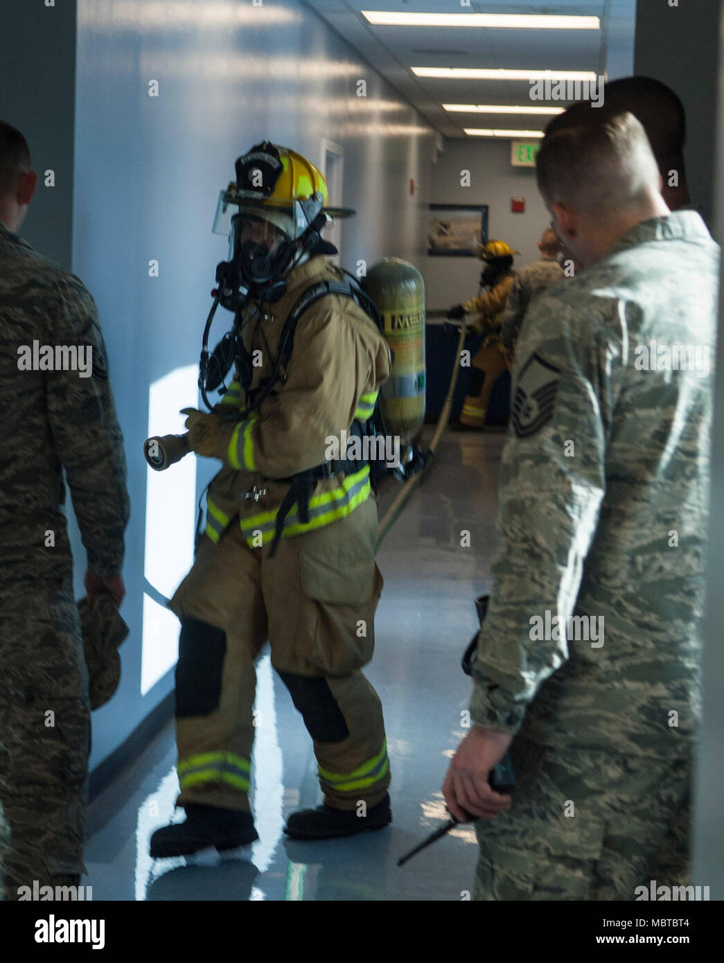 """Master Sgt. Jason Legget, a firefighter supervisor assigned to the 152nd Civil Engineer Squadron is overseeing firefighters in a structure at the Nevada Air National Guard base January 7, 2018.  Leggett said """"Exercises like this get the firefighters out of their comfort zone."""" Stock Photo"""