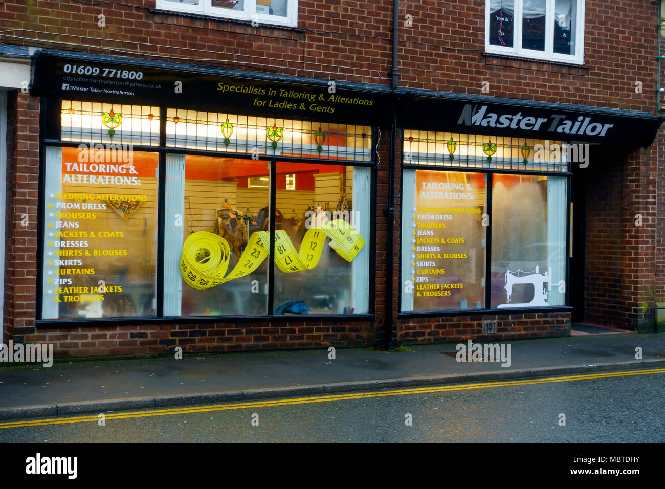 Busy Tailors Shop specialising in repairs and alterations to clothing in a North Yorkshire Market Town - Stock Image