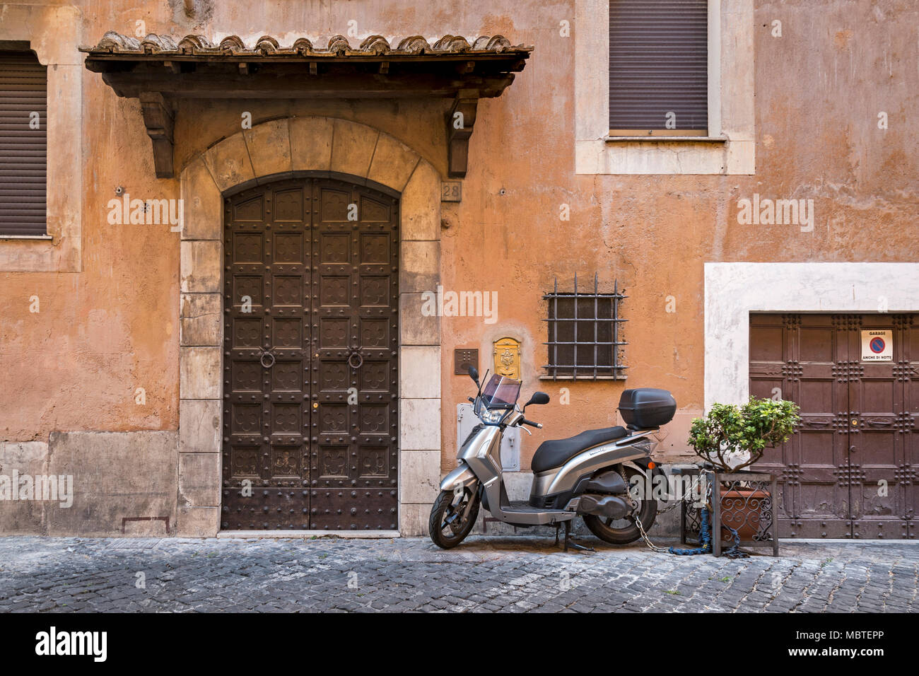 Is The Front Door Big Or The Garage Door Small A Residential Street In Rome Italy The Facade Of A Villa With Weathered Exterior In Shades Of Terrac Stock Photo Alamy