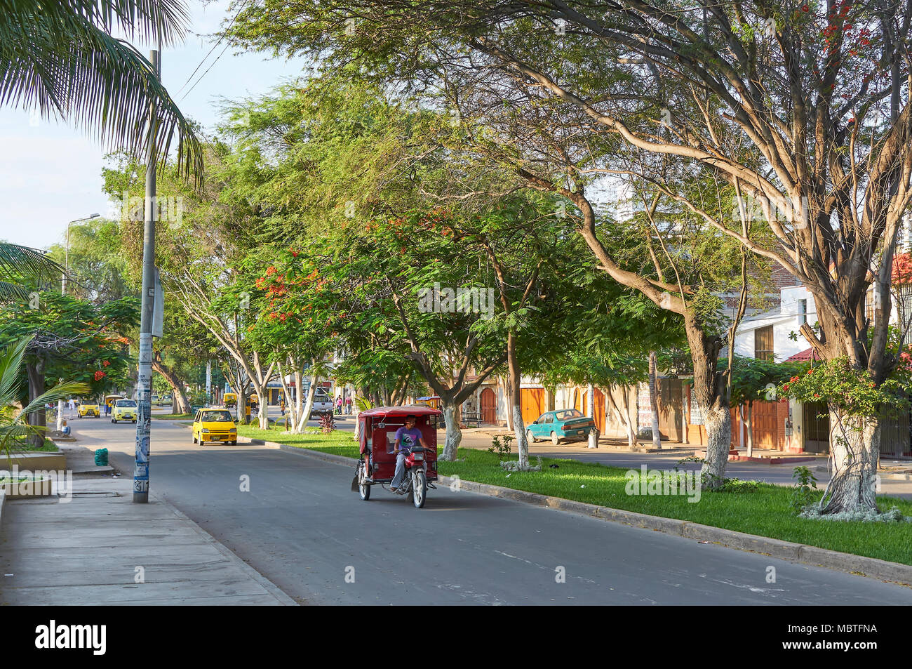 A motorcycle Taxi, one of the several thousand that can be found in this region of Peru, in the Coastal City of Paita in the Piura Region of Peru, Sou - Stock Image
