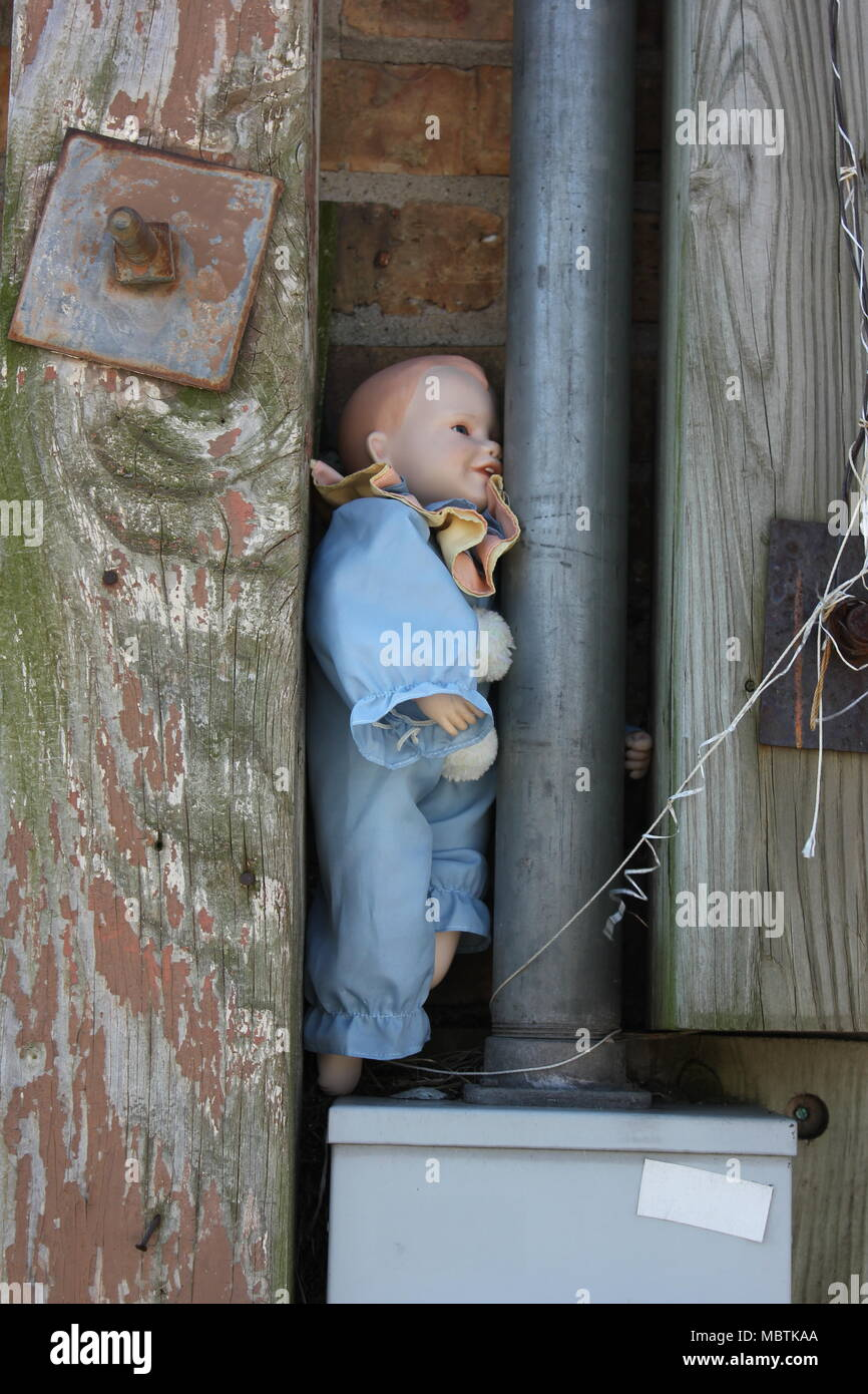 Imagery of an abandoned doll in a commercial back alley in Chicago Stock Photo