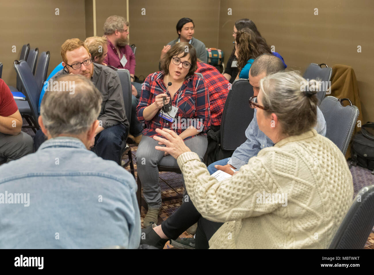 Chicago, Illinois - Johanna Parker translates from English to Spanish for Spanish speakers attending a workshop during biannual Labor Notes conference - Stock Image