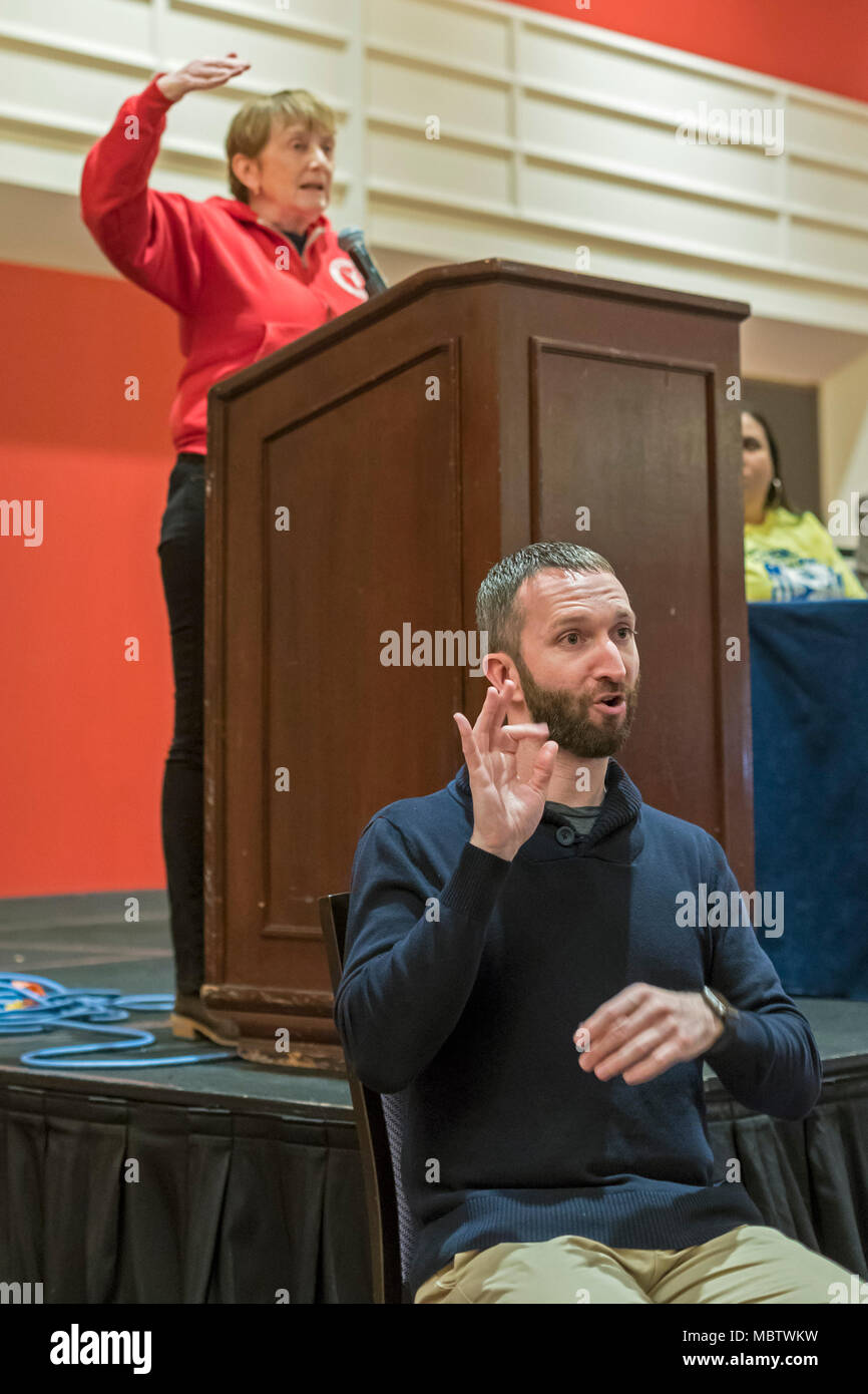 Chicago, Illinois - A sign language interpreter at work while Barbara Madeloni, president of the Massachusetts Teachers Association, speaks at the bia - Stock Image