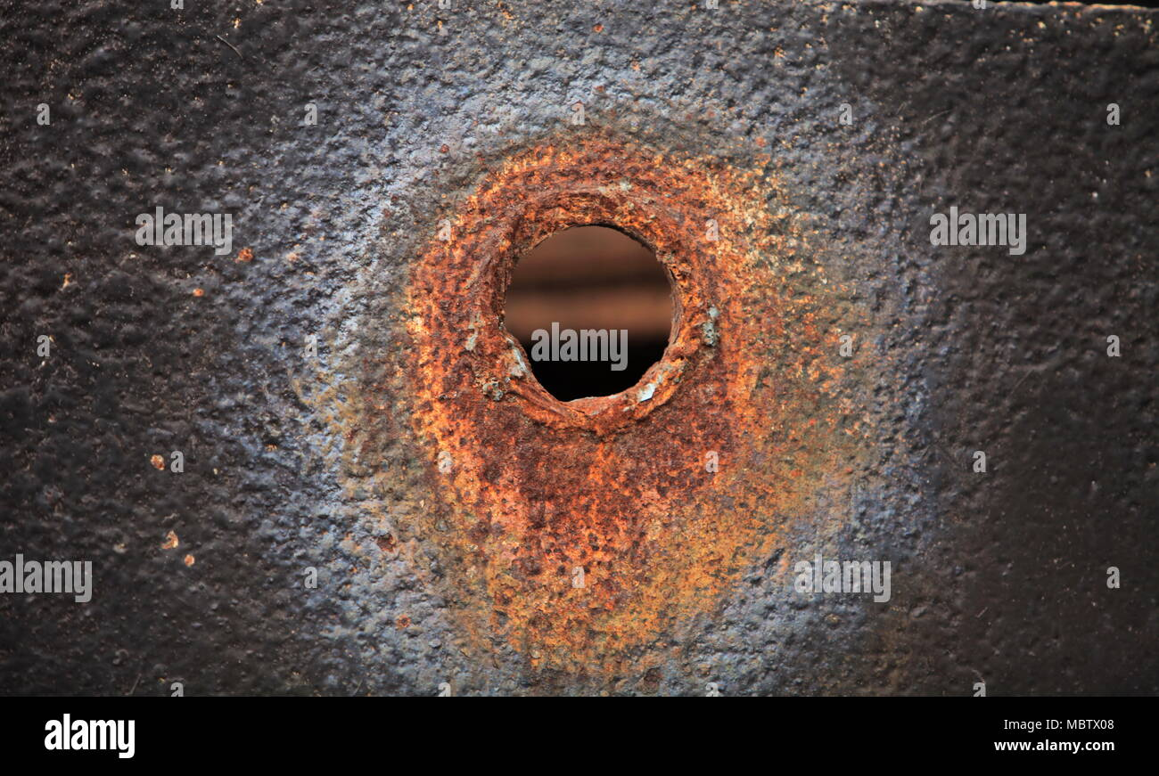 a bullet hole in the steel sheet - Stock Image