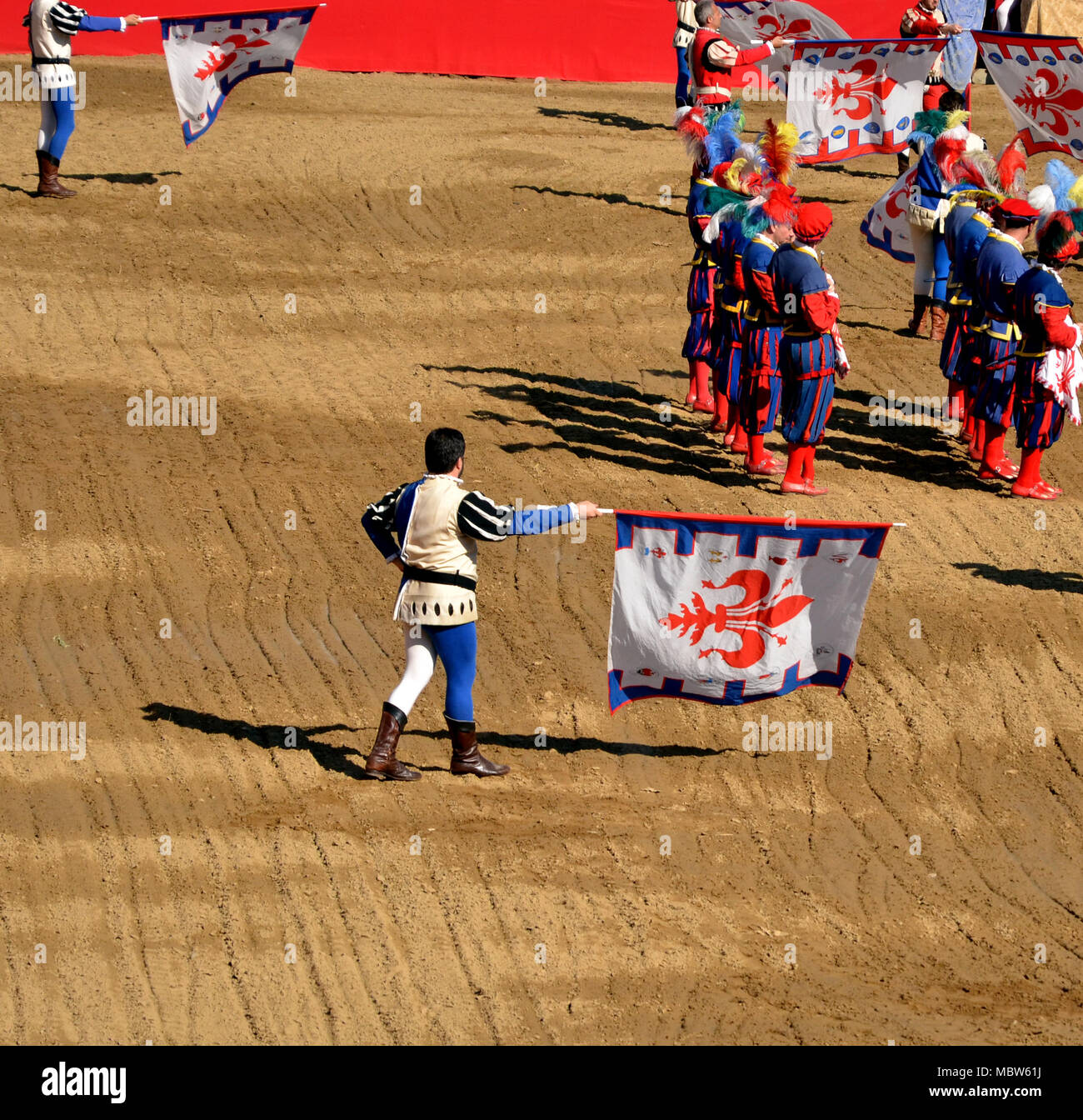 Flag wavers during a performance of historic football in Florence - Stock Image