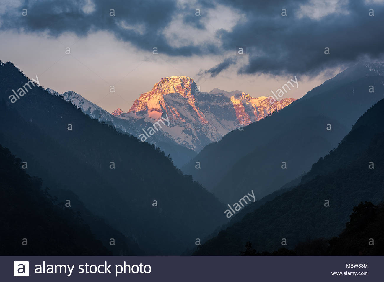 Sunrise over Khang Bum, Gasa Valley, Bhutan on a fine day in March. - Stock Image