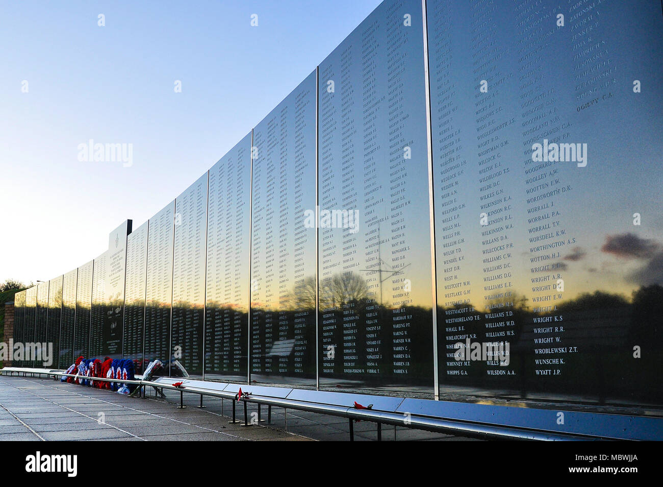 Battle of Britain Memorial, Capel-le-Ferne, Christopher Foxley-Norris Memorial Wall at sunset. Kent. Fight pilot's names. Royal Air Force wreaths - Stock Image