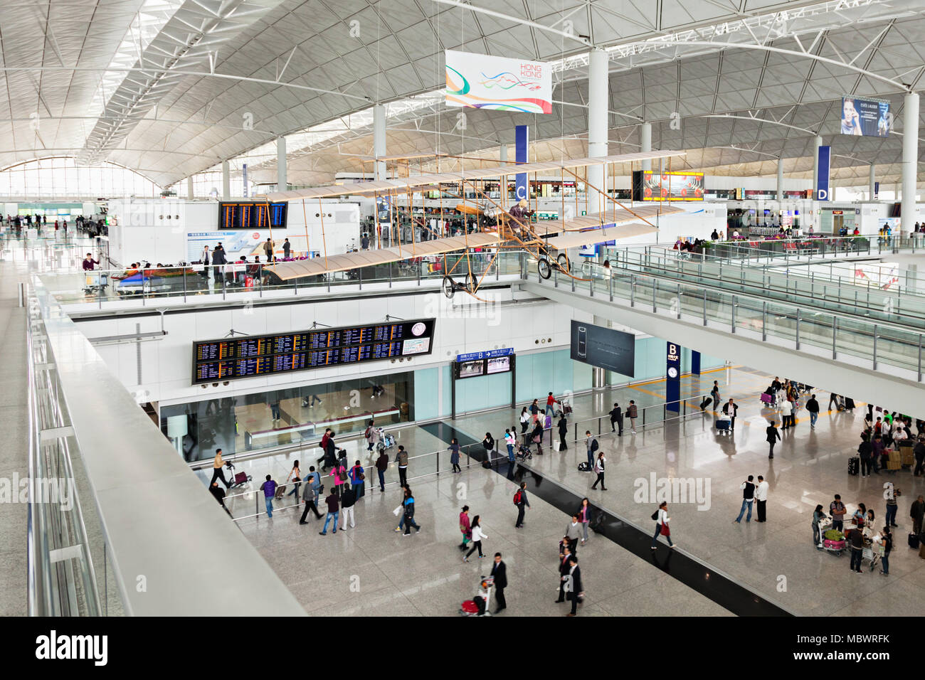 HONG KONG, CHINA - FEBRUARY 21: Passengers in the airport main lobby on February 21, 2013 in Hong Kong, China. The Hong Kong airport handles more than - Stock Image