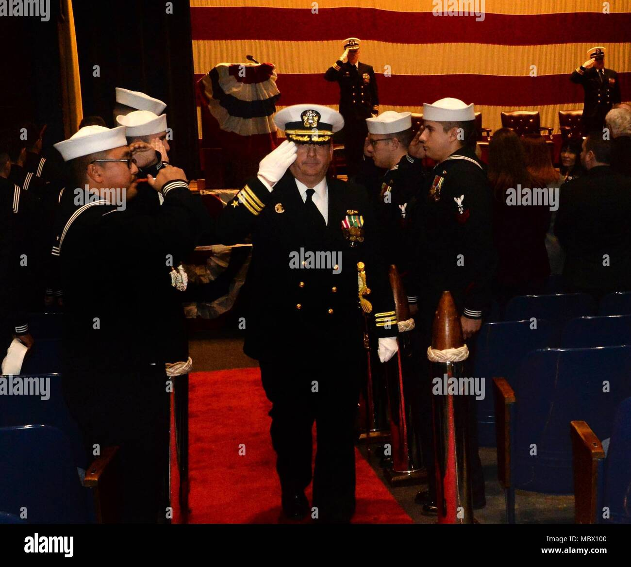 18011-N-LW591-028 GROTON, Conn. (Nov.17, 2017) Oklahoma City, Okla. native ¬Cmdr. Neil Colston, former commanding officer of the nuclear-powered Los Angeles class, fast-attack submarine, USS Pittsburgh (SSN 720), is rung ashore following a change of command ceremony after being relieved by Pittsburgh, Pa. native Cmdr. Jason Deichler at the Dealey Theater, Naval Submarine Base, New London in Groton, Conn. on Friday, Jan.12. (U.S. Navy photo by Mass Communication Specialist First Class Steven Hoskins/Released) - Stock Image