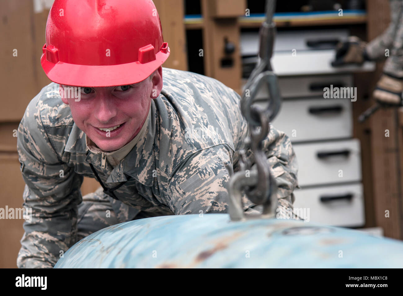 Airman 1st Class Colten Carey, 23d Maintenance Squadron (MXS) precision guided munitions technician, rotates a Joint Direct Attack Munition, Jan. 11, 2018, at Moody Air Force Base, Ga. The 23d MXS held a combat munitions class to help acclimate and improve their Airmen's readiness to perform well in a deployed environment. (U.S. Air Force photo by Airman Eugene Oliver) - Stock Image