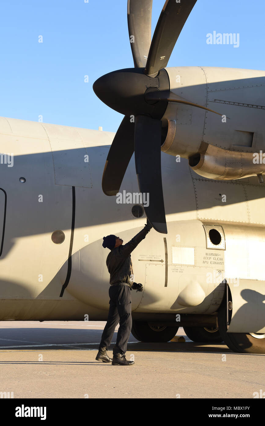 An Indian Air Force crew member manually rotates the propellers of a C-130 Hercules Jan. 13, 2018, after landing at Grand Forks Air Force Base, N.D. before heading to McChord AFB, Wash. for exercise Vajra Prahar. (U.S. Air Force photo by Airman 1st Class Elora J. Martinez) - Stock Image