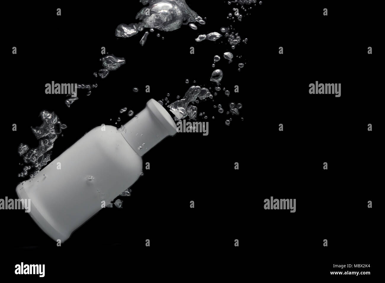 Perfume in the background of splashes, space for text - Stock Image