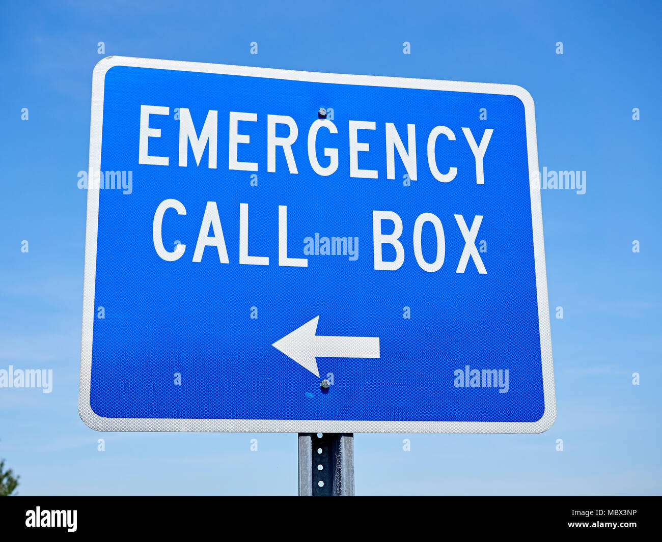 Emergency call box sign pointing in the direction of a communication box that notifies a 911 operator of trouble or an emergency in Alabama USA. - Stock Image