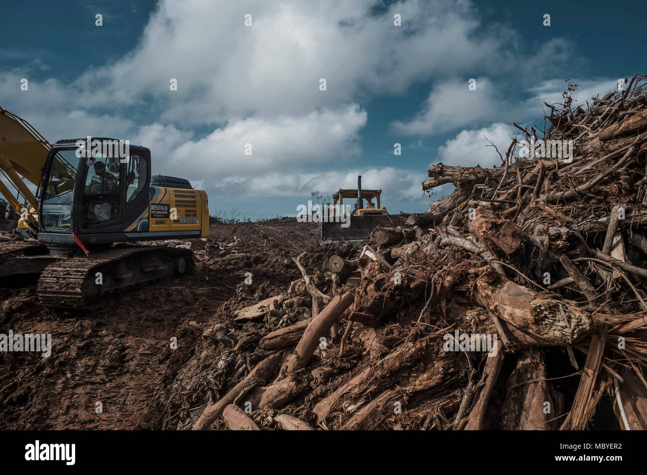 NARANJITO, Puerto Rico, Jan. 8, 2018--Employees of the municipality of Naranjito collect debris to be taken to the regional landfill located in the municipality of Toa Baja. - Stock Image