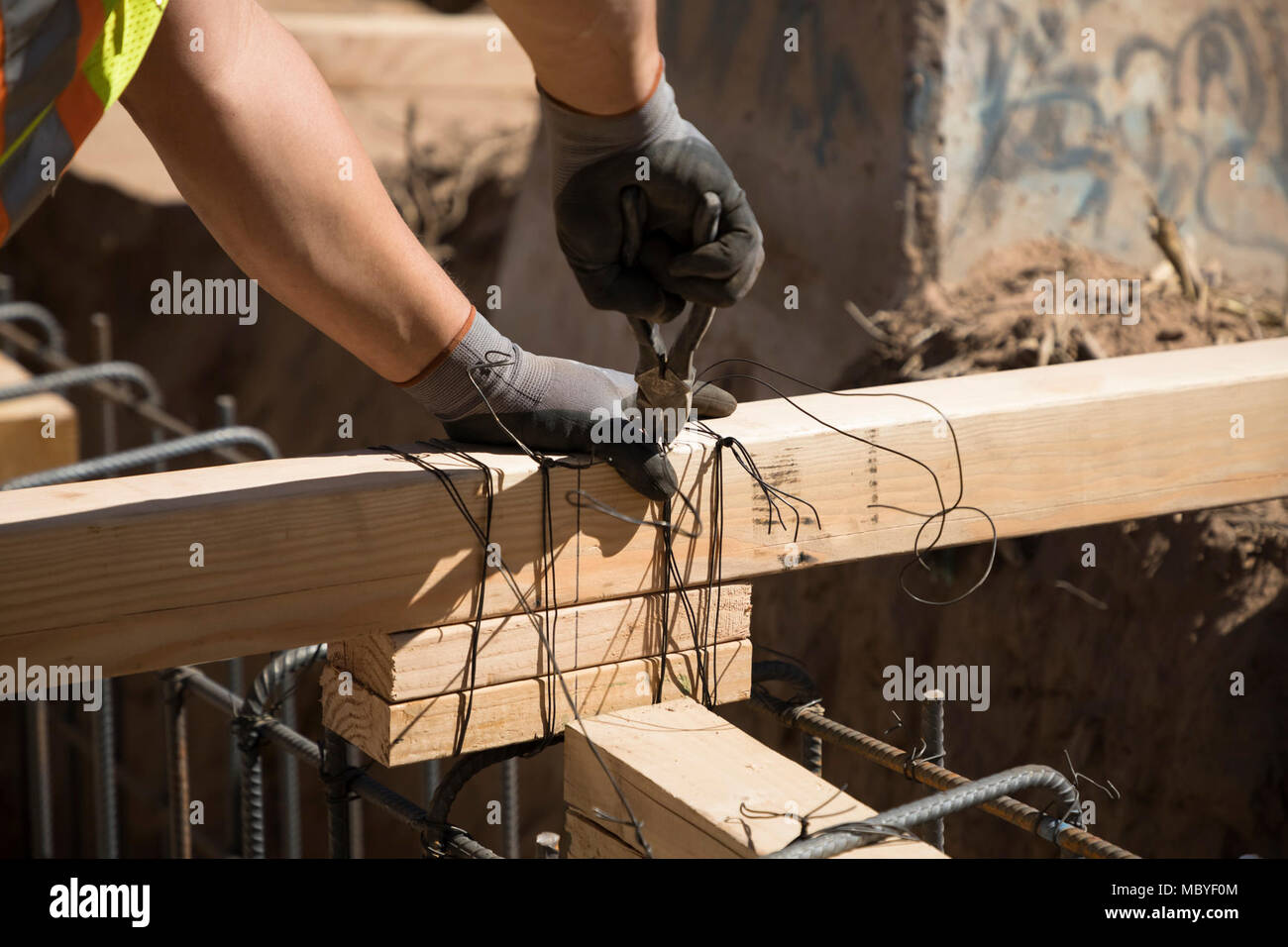 Repair work begins on a 2 1/4 mile section of Border Fence in El Centro Sector near the Calexico West Port of Entry. Stock Photo