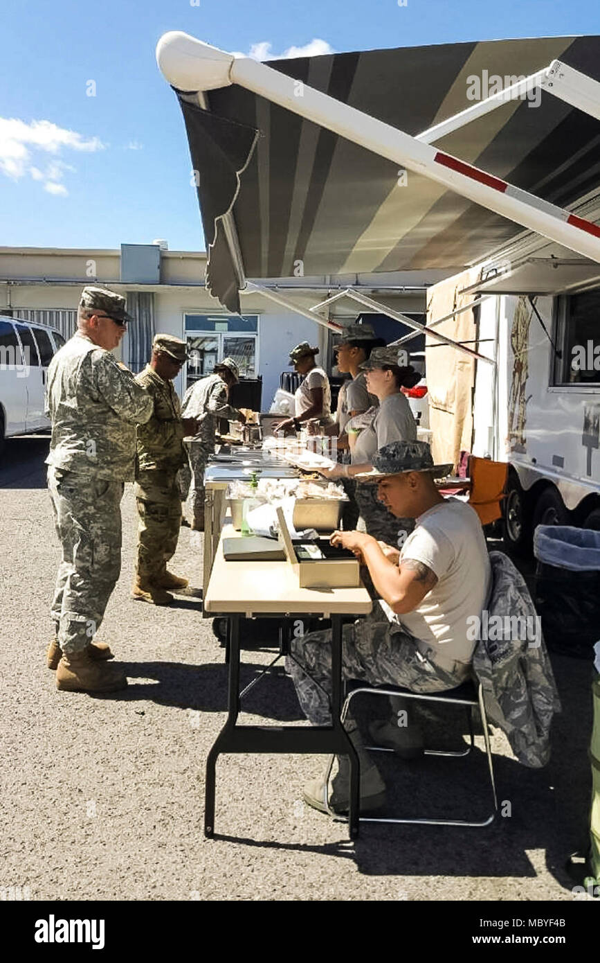 U.S. Air Force services specialists serve meals from a Disaster ...