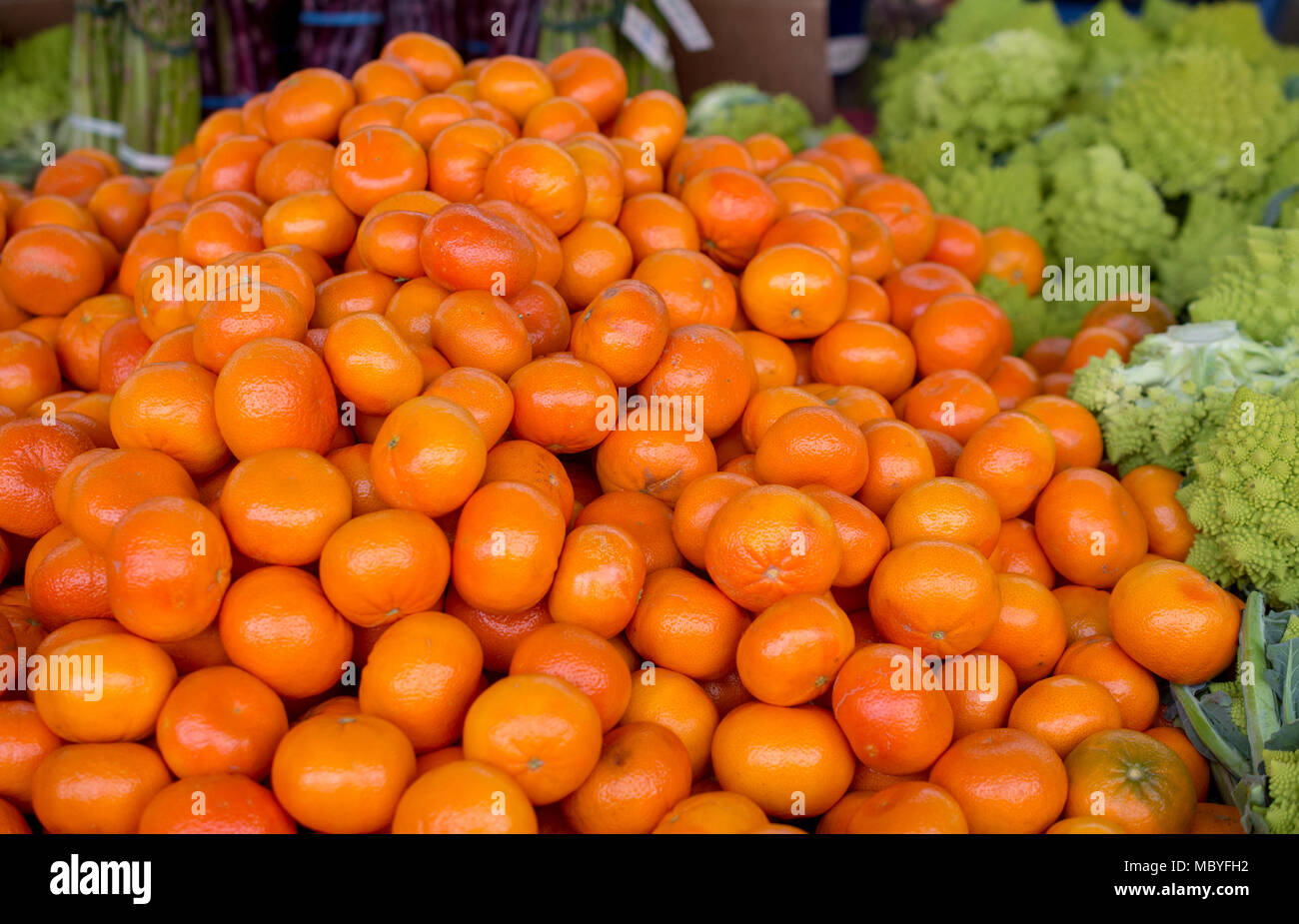 Orange Color Tangerine Citrus Available At A Farmers Market For Sale Surrounded By Vegetables