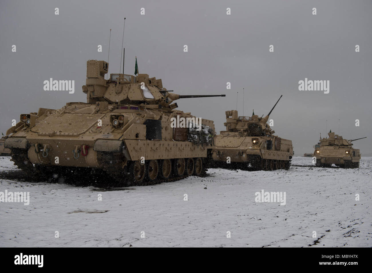 Engineers with the 116th Brigade Engineer Battalion conduct M2A3 Bradley fighting vehicle gunnery qualification on March 27, 2018, Orchard Combat Training Center, south of Boise, Idaho. Combat engineers with the 116th BEB trained through gunnery table XII, evaluating their ability to execute collective platoon-level tasks in a tactical live-fire environment; including integrating dismounted soldiers with their assigned BFV. Stock Photo