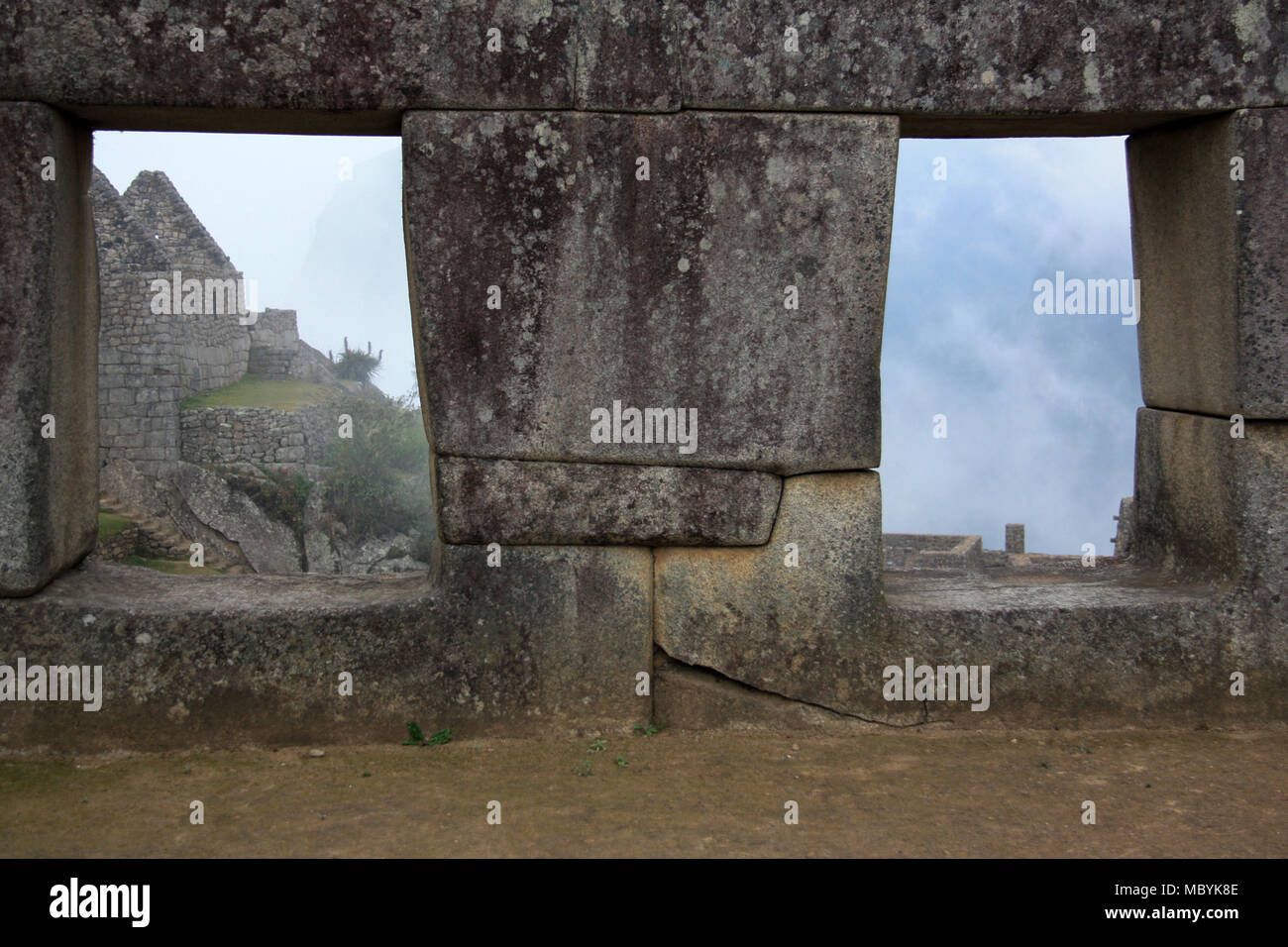 Trapezoidal windows of a building at the abandoned citadel of Machu Picchu on top of a Mountain Ridge above the Sacred Valley within the Rainforest - Stock Image